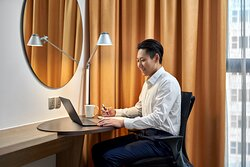 Ergonomic work desk and free in-room Wi-Fi to stay connected