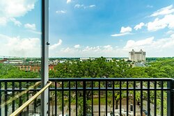 Step out & enjoy a balcony view of Savannah's Historic Downtown