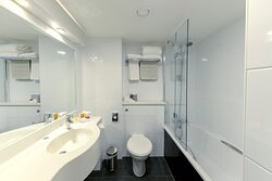Guest bathrooms include bath / shower and toiletries