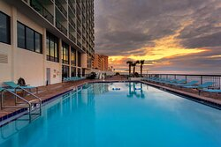 Watch a Daytona Beach sunset from the pool