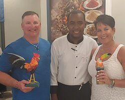 Our favorite waiter Sandy with the painted wood birds he gave us. He's awesome!