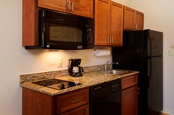 Full Kitchen with Dining - Work Space in All Guest Suites
