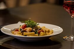 Order your favorite wine with our delicious pasta entrée