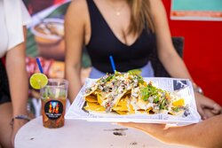 Juan Nachos! – Corn chips with chicken and/or steak, cover with house cheese and pico de gallo.
