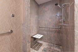 Accessible Larger Studio Suite Bathroom - Roll-In Shower
