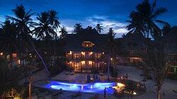 Evening shot Karafuu villa & the central pool.
