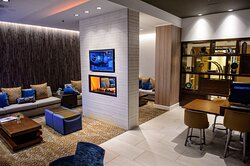 Relax and unwind while awaiting the hotel shuttle to the airport