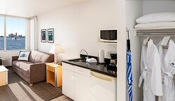 Deluxe Waterfront Suites feature convenience centers with refrigerator, microwave, coffee maker and bar sink. All suites feature plush robes for our guests' comfort.