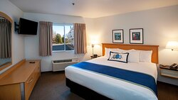 Deluxe Waterfront Suites feature a king bed in the bedroom.