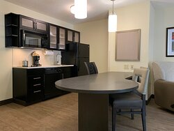 Queen One Bedroom Suite Kitchen and Dining Table