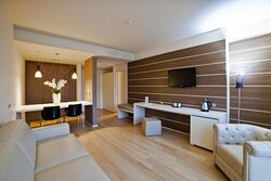 Living Area in the Suite Room with dining table and a stylish kitchen cabinet