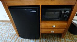 Console with frig and Microwave and TV is on top