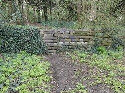 Brenchley Garden, Honor Oak, South London: restored granite embankment along the former railway track