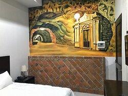 Cada habitación cuenta con un mural referente a un Pueblo Mágico de México.