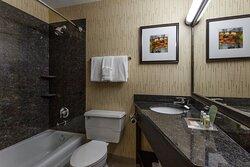 Wonderfully lit, modern bathroom with great space