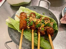 marinated pork sausage skewers, with roasted peanuts, fried shallots, fresh herbs and tamarind nuoc cham dressing