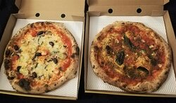Veggie pizza with vegan mozzarella on the left, Marinara pizza on the right
