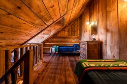 Each room in the main lodge has a loft with two twin beds.  Photo credit: @NelsonStegallPhotography