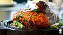 TANDOORI CHICKEN Chicken marinated in yogurt, ginger, garlic, lemon and Indian spice- blend, cooked in a clay oven