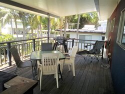 All-weather covered deck with dining and BBQ.