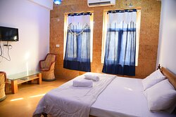 Spacious Deluxe AC rooms with king size beds, life size windows, seating areas and huge bathrooms (shower with 24*7 running hot/cold water)