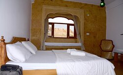 Spacious Deluxe non-AC rooms with king size beds, life size windows, seating areas and huge bathrooms (shower with 24*7 running hot/cold water) with fort view
