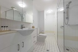 Shower area in front of sink
