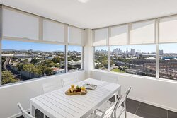 Interior view of dining area in Two Bedroom Suite with city view