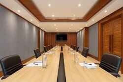 Interior view of Covid-19 boardroom setup in Dol-Jai Meeting Room with face masks and hand sanitiser gel