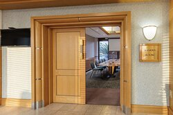 Wooden door to meeting room open