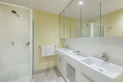 Interior view of bathroom in Two Bedroom Executive Suite with shower and vanity