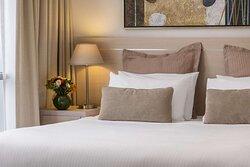 Bedside details in bedroom of Two Bedroom Suite
