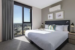 Interior view of bedroom in Two Bedroom Executive Suite with city view