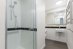 Interior view of bathroom in Two Bedroom Executive Suite with city view