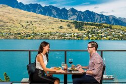 Man and woman enjoying their food at the outdoor restaurant