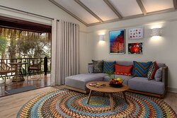 Interior view of lounge in African-themed bedroom at Beach Pool Villa with garden view