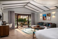 Interior view of bedroom in Beach Pool Villa and Beach Villa with lounge and terrace view