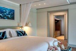 Interior view of marine-themed bedroom to bathroom at Beach Pool Villa and Beach Villa