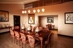 Interior view of dining area in Avani Presidential Suite dining area with décor details