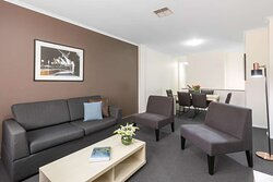 Interior view of lounge, dining area and kitchen in Two Bedroom City Skyline Executive Apartment