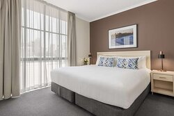 Interior view of bedroom in Two Bedroom City Skyline Executive Apartment