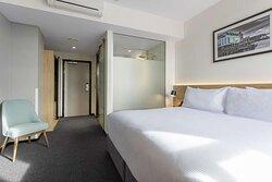 View of the hotel room door and hallway from the bedroom