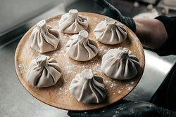 """""""Khinkali"""" - so called Georgian Dumplings, are getting ready to be boiled in hot water."""