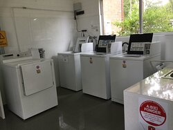 Laundry facilities with a book library.