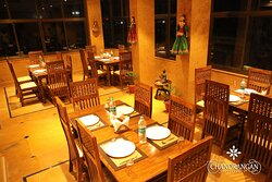 Immerse into the joy of togetherness with your family with an amazing dining experience in our family dining hall. Decorated with traditional handicraft interior and furniture, indulge in the traditional ambiance with delicious and heart-warming Rajasthani cuisine. Our family dining hall is best for family celebrations and get-togethers. Create joyful memories with a splendid dining experience.