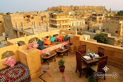 Enjoy a hearty traditional Rajasthani cuisine, intercontinental cuisines, and much more with a spectacular fort view of Golden fort with our rooftop dining services. The traditional soothing decor and lights, with chef's North Indian delicacies, will surely make it a perfect time spent at Chandranjan rooftop restaurant in Jaisalmer. Relax and enjoy the spectacular view and plan your next Jaisalmer adventure over some warm hearty meals!