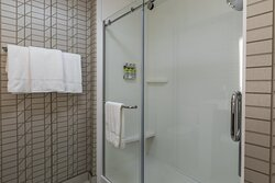 spacious stand up shower with Green Engage Toiletries