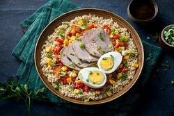 Protein Power Quinoa Bowl- Quinoa bowl with roasted beef, seasoned corn, roasted red peppers, a hard boiled egg, and green onions with your Choice of Dressing (served on the side).