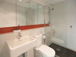 Interior view of bathroom in One Bedroom Suite with shower