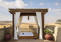 Exterior view of Thai Sala cabana for traditional Anantara Spa massage treatments with desert view